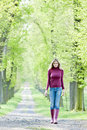 Woman In Spring Alley Royalty Free Stock Photography - 23868717