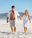 Carefree Walking Beach Couple Stock Images - 23871884