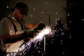 Men At Work Grinding Steel Royalty Free Stock Photos - 23887138