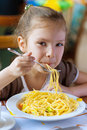 Small Girl Eating Spaghetti Royalty Free Stock Photo - 23902265