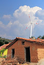 Old Mud House In Rural India With Wind Mill Royalty Free Stock Images - 23917219