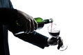 Close Up Man Hands Pouring Red Wine In A Glass Stock Image - 23923131