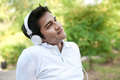 Asian Man With White Headphones Royalty Free Stock Images - 23930489