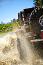 Big Jeep Splashing Mud In The Mountains 3 Stock Images - 23950654