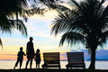 Silhouettes Of Mother And Two Kids Stock Photo - 23957040