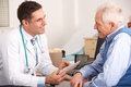Elderly Man Talking With An American Doctor Stock Photography - 23958702