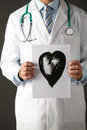 American Doctor Holding Ink Drawing Of Heart Royalty Free Stock Photos - 23959068