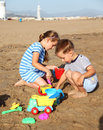 Kids Playing On The Beach Royalty Free Stock Image - 23963386