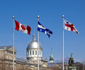Flags Of Canada, Quebec And Montreal In Old Port Royalty Free Stock Image - 23980046