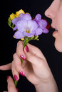 Woman Sniffing Flowers, Freesia Royalty Free Stock Photos - 23982158