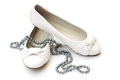 White Ladies Shoes With Silver Pearl Necklace Royalty Free Stock Photography - 23995297