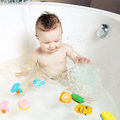 Cute Smiling Baby Taking A Bath Stock Photography - 24003502