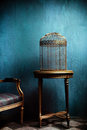 Louis Table And Old Golden Bird Cage Royalty Free Stock Images - 24007599