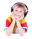 Portrait Of A Sweet Young Boy Listening To Music Royalty Free Stock Photos - 24056578