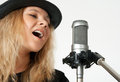 Young Woman Singing With Studio Microphone Royalty Free Stock Photo - 24081245