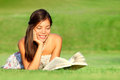 Woman Reading Book In Park Stock Images - 24084984