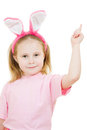 Little Girl With Pink Ears Bunny Points To The Top Stock Image - 24089151