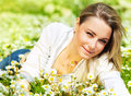 Beautiful Female Laying On The Flower Filed Royalty Free Stock Image - 24095226