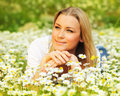Beautiful Female Laying On The Flower Filed Stock Images - 24095254