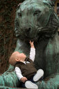 The Baby And The Lion Royalty Free Stock Images - 2412729