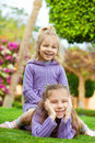 Two Sisters Playing On Green Meadow Stock Photo - 24101500