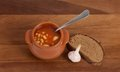 Soup In Clay Pot With Bread And Garlic Royalty Free Stock Photo - 24122505