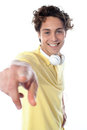 Guy With Headphones Pointing At You Royalty Free Stock Photo - 24140225