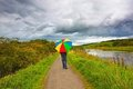 A Man Walking In The Rain Royalty Free Stock Images - 24163659