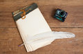 Old Notebook, Quill Ink Pen And Inkwell On Wood Ba Royalty Free Stock Image - 24179916