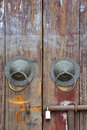 Aged Wooden Door With Knocker And Lock Royalty Free Stock Photos - 24194748