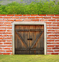 Brick Wall With Door And Trees Stock Images - 24203494