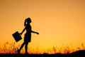 Business Woman Standing And Sunset Silhouette Stock Image - 24215031