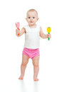 Standing Baby Playing With Musical Toy Stock Photography - 24237152