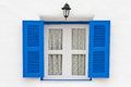 Blue Window And Lamp On White House Royalty Free Stock Images - 24277319