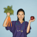 Doctor, Apple And Carrots. Stock Photography - 2431952