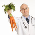 Doctor Holding Carrots. Stock Photo - 2431970