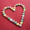 Candy Hearts On Red. Stock Photos - 2432303