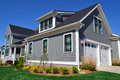 Grey And Black Cape Cod Style Home Stock Image - 24309421