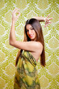 Asian Indian Brunette Girl With Long Hair Dancing Royalty Free Stock Photos - 24316778