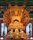 Golden Wood Statue Of Guan Yin With 1000 Hands Stock Image - 24335861