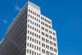 Skyscraper In Front Of A Blue Sky Royalty Free Stock Photography - 24336657