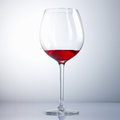 Half Drunk Wine Glass Royalty Free Stock Photo - 24339345