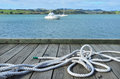 Sailing Rope On A Wharf Pier With Boats In The Bac Stock Photo - 24351950
