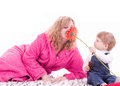 Mother And Young Baby Boy With Red Flower Stock Photos - 24360253