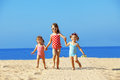 Kids Playing At The Beach Royalty Free Stock Image - 24374516