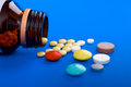 Spilled Tablets And Medicine Bottle. Stock Photography - 24394042