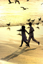 Couple Running In The Beach Royalty Free Stock Photography - 2448127