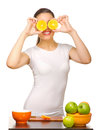 Young Girl With Orange Slices Royalty Free Stock Photography - 24431547