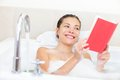 Woman Reading Book In Bath Stock Photography - 24433382