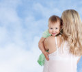 Mother With Cute Baby Girl Looking Over Shoulder Stock Photo - 24439490
